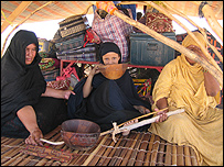 Braika (in black) and her friend (in yellow), showing how they force-feed the girls and the instruments they use