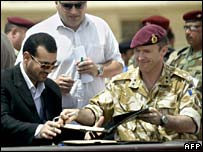 Maysan governor Adel Mhoder and British commander Maj Gen Jonathan Shaw at security handover ceremony