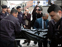 Turkish police carry one of the victims from the publishing house