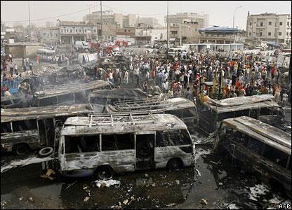 Burnt-out buses at Sadriya market