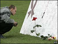 A student at a memorial on the Virginia Tech campus