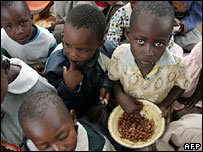 Zimbabwe school children with bowls of food