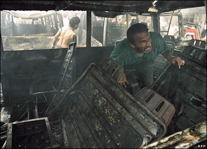 Man weeping in interior of destroyed bus