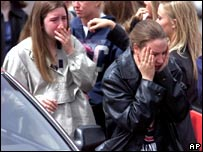 Columbine High School students cry after visiting the site of the shooting spree