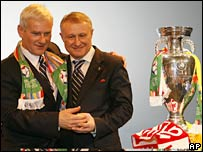 Polish Football Association chairman Michal Listkiewicz (left) and Hryhory Surkis, President of Ukraine's Football Association look at the trophy in Cardiff