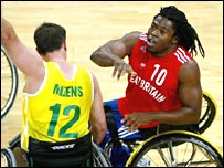 Former GB wheelchair basketball player Ade Adepitan (r) challenges in Athens