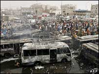 Iraqis gather at the site of a car bomb blast in Baghdad's Sadriya district