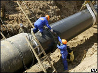 Workers lay a gas pipeline near Boksitogorsk