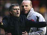 Steve Bennett restrains Chelsea boss Jose Mourinho during a game last year