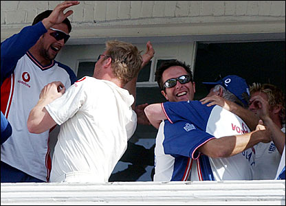 The England balcony celebrates after beating New Zealand at Trent Bridge