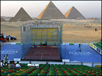 A glass court with the Pyramids in the background