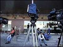 TV crews await news on Maradona outside the clinic in Buenos Aires