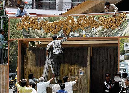 Workers decorate the entrance of Prateeksha - one of the family residences of Bollywood film actor Amitabh Bachchan