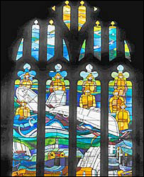 The stained glass window at All Saints Church in Mumbles