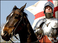 Man posing as St George on a horse