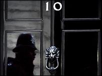Policeman's reflection at Downing Street