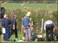 The pilot being treated at the scene. Photo: Dennis Morris