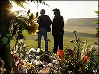 Father of a Columbine High School shooting victim visits a makeshift memorial at Virginia Tech