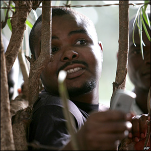 A Malawian man with a mobile phone