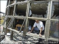 Person looking through damaged windows