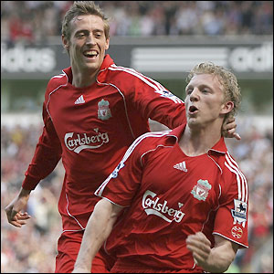 Dirk Kuyt celebrates after heading in Jermaine Pennant's cross frrom the right