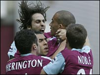West Ham players mob Bobby Zamora after his opener against Everton