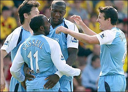 Man City players celebrate Vassell's 53rd-minute goal