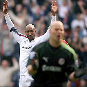 Anelka celebrates after watching his shot find its way in