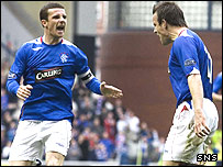 Barry Ferguson and Gavin Rae celebrate at Ibrox