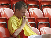A dejected Watford fan after his side were relegated from the Premiership