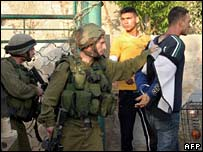 Israeli forces carry out arrests in the village of Kafr Dan