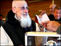 Monk Aimable, the oldest member of Mont des Cats' Abbey, casts his ballot in Godewaersvelde, northern France