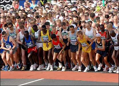 The main body of runners prepare to cross the start line