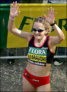 Mara Yamauchi celebrates after crossing the finish line