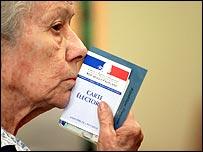 Woman holding ballot paper