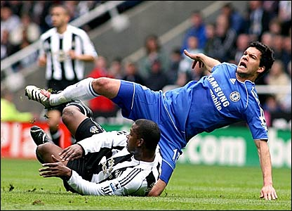 Titus Bramble (bottom) fouls Michael Ballack