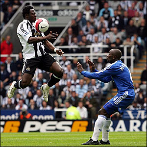 Newcastle's Obafemi Martins controls the ball in front of Chelsea's Claude Makelele
