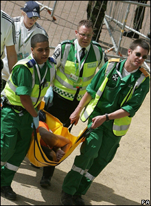 Runner being carried by paramedics after the London Marathon