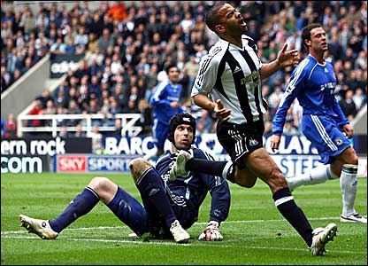 Chelsea goalkeeper Petr Cech (left) looks on as Kieron Dyer realises his shot has been deflected over the bar
