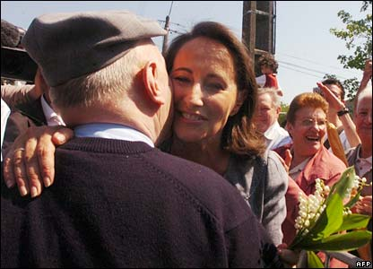 Segolene Royal kisses a man prior to voting in Melle, central France