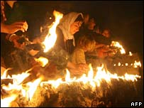 Yazidis near the town of Dohuk light candles and paraffin torches to celebrate to celebrate the Yazidi New Year on 17 April 2007