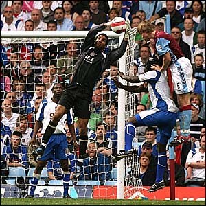 Portsmouth keeper David James catches the ball