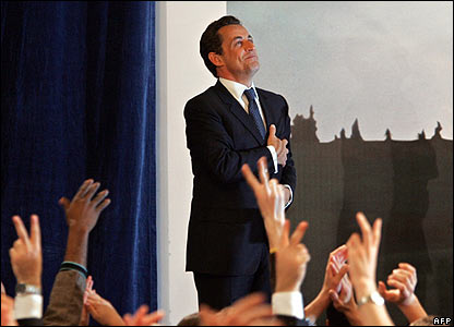 Nicolas Sarkozy is cheered by supporters after emerging top in the first round