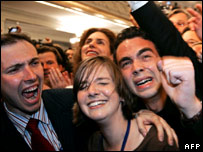 Supporters of Nicolas Sarkozy listen to the results
