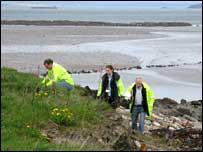 Edinburgh council officials on beach