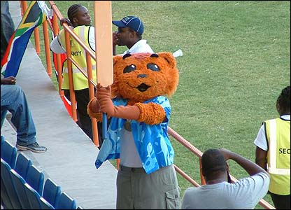 Amanda's final shot shows World Cup mascot Mello entertaining the crowds with the help of a huge bat