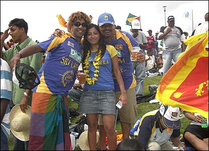 In this photo Dayalan wears a Malinga wig and sarong with friends at Sri Lanka's match against West Indies in Guyana
