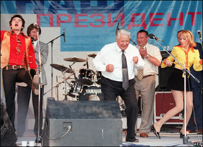 Russian President Boris Yeltsin (R) in Rostov, dancing with musicians during a rock performance as part of his pre-election campaign in 1996
