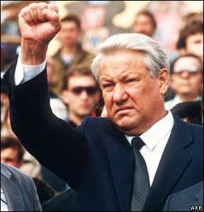 Russian President Boris Yeltsin clenching a fist during the funeral of three young men killed during the coup attempt of mid-August in 1991.