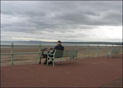Man on bench at beach